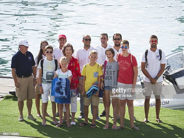 Spain's Queen Sofia poses with her grandchildren Pablo Nicolas Irene Miguel Victoria Federica and Juan Valentin on the first day at their sailing...