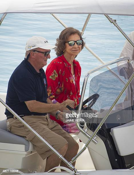 Spain's Queen Sofia sits on a boat as she looks at her grandchildren on the first day at a sailing school in Palma de Mallorca on July 27 2015 The...