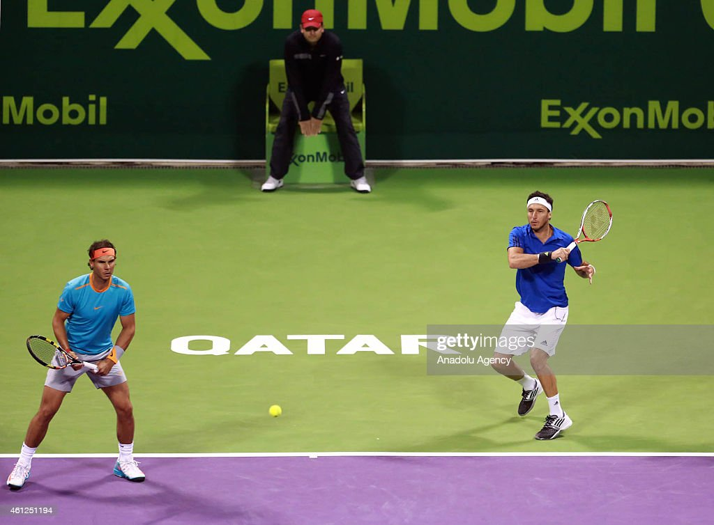 Spain's Rafael Nadal (L) and Argentina's Juan Monaco (R) in action against Austria's Julian Knowle and Philipp Oswald during their men's doubles final match at the Qatar ExxonMobil Open tennis tournament at the Khalifa Tennis Complex in Doha, Qatar on January 09, 2015.