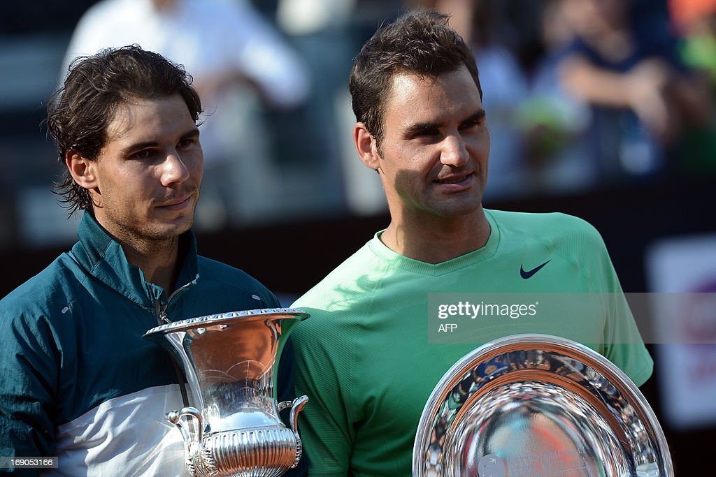 Spain's Rafael Nadal (L) and Switzerland's Roger Federer pose during the trophy ceremony of the ATP Rome Masters on May 19, 2013. Nadal crushes Switzerland's Roger Federer 6-1, 6-3 to win seventh Rome title. AFP PHOTO / FILIPPO MONTEFORTE