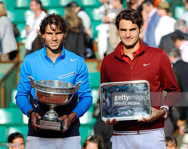 Spain's Rafael Nadal and Switzerland's Roger Federer pose with their trophies after Nadal won their Men's final match in the French Open tennis...