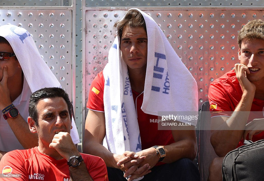 Spain's Rafael Nadal (C) attends the Davis Cup World Group Play-offs 2013 matc Ukraine's Denys Molchanov vs Spain's Marc Lopez at the Caja Magica sports complex in Madrid on September 15, 2013. Lopez won 6-3, 6-3. AFP PHOTO/ GERARD JULIEN