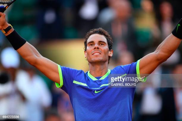 Spain's Rafael Nadal celebrates after winning against Austria's Dominic Thiem their semifinal tennis match at the Roland Garros 2017 French Open on...