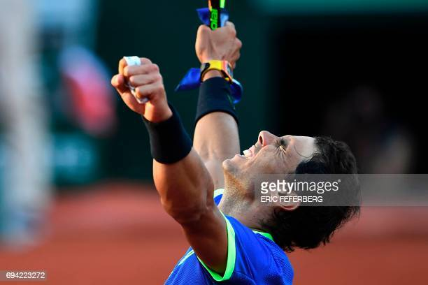 Spain's Rafael Nadal celebrates after winning his semifinal tennis match against Austria's Dominic Thiem at the Roland Garros 2017 French Open on...