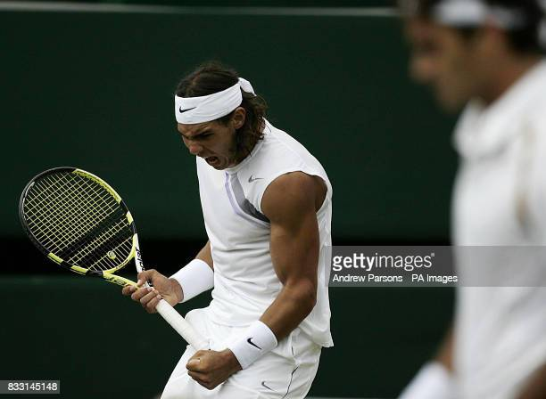 Spain's Rafael Nadal celebrates against Switzerland's Roger Federer during the Men's Final of The All England Lawn Tennis Championship at Wimbledon