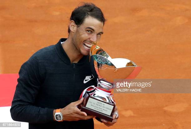 Spain's Rafael Nadal celebrates and bites the trophy during the prize ceremony after winning the MonteCarlo ATP Masters Series Tournament final...