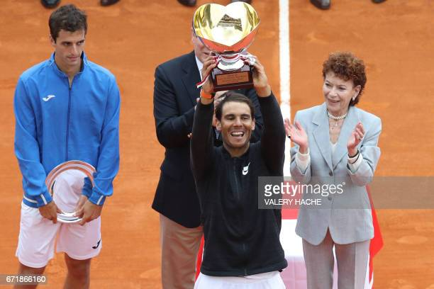 Spain's Rafael Nadal celebrates as he brandishes his trophy during the prize ceremony after winning the MonteCarlo ATP Masters Series Tournament...