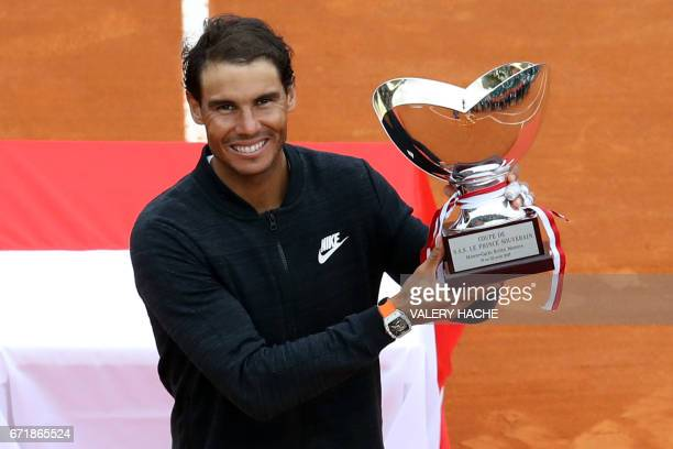 Spain's Rafael Nadal celebrates as he holds the trophy during the prize ceremony after winning the MonteCarlo ATP Masters Series Tournament final...