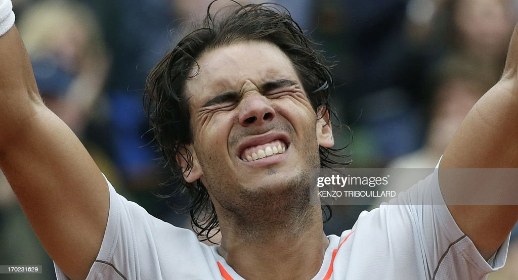 Spain's Rafael Nadal celebrates as he wins the 2013 French tennis Open final against Spain's David Ferrer at the Roland Garros stadium in Paris on June 9, 2013. AFP PHOTO / KENZO TRIBOUILLARD