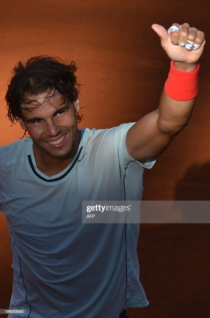 Spain's Rafael Nadal celebrates defeating Switzerland's Roger Federer at the end of the final of the ATP Rome Masters on May 19, 2013. Nadal crushes Federer 6-1, 6-3 to win seventh Rome title.