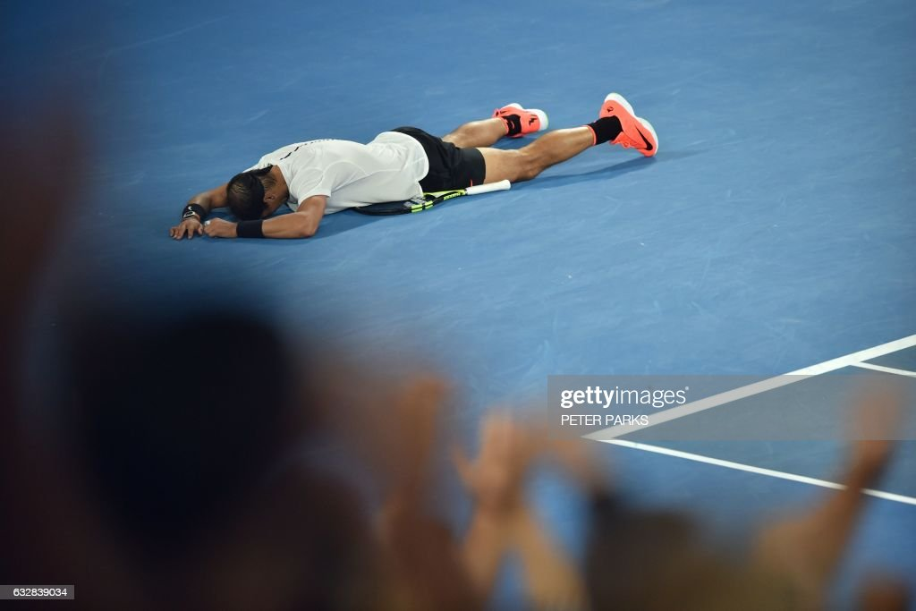 TOPSHOT - Spain's Rafael Nadal celebrates his victory against Bulgaria's Grigor Dimitrov during their men's singles semi-final match on day 12 of the Australian Open tennis tournament in Melbourne on January 28, 2017. / AFP / PETER