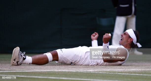 Spain's Rafael Nadal celebrates his victory over Switzerland's Roger Federer in the Mens Final during the Wimbledon Championships 2008 at the All...