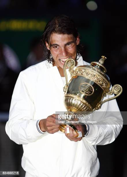 Spain's Rafael Nadal celebrates his victory over Switzerland's Roger Federer following the Men's Final during the Wimbledon Championships 2008 at the...