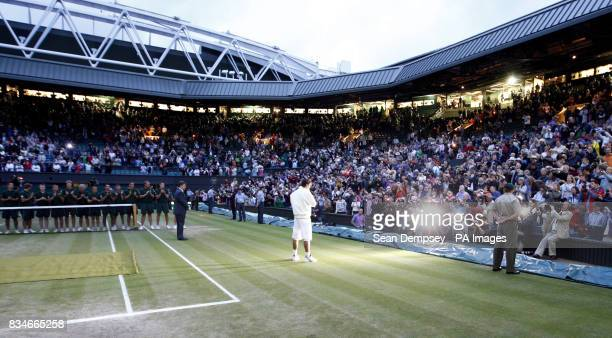Spain's Rafael Nadal celebrates his victory over Switzerland's Roger Federer following the Mens Final during the Wimbledon Championships 2008 at the...