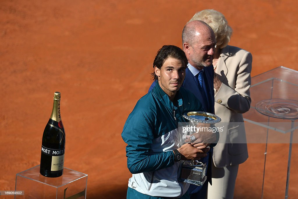 Spain's Rafael Nadal celebrates with the cup during the trophy ceremony of the ATP Rome Masters on May 19, 2013. Nadal crushes Switzerland's Roger Federer 6-1, 6-3 to win seventh Rome title.