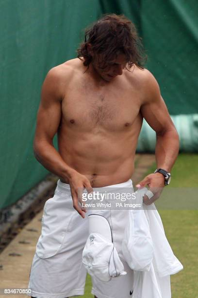 Spain's Rafael Nadal changes tops during the Wimbledon Championships 2008 at the All England Tennis Club in Wimbledon
