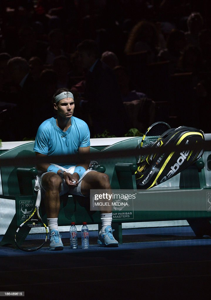 Spain's Rafael Nadal concentrates before a third round match against Poland's Jerzy Janowicz at the ninth and final ATP World Tour Masters 1000 indoor tennis tournament on October 31, 2013 at the Bercy Palais-Omnisport (POPB) in Paris. AFP PHOTO / MIGUEL MEDINA