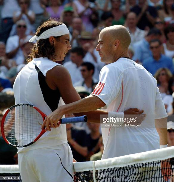Spain's Rafael Nadal consoles USA's Andre Agassi during the third round of The All England Lawn Tennis Championships at Wimbledon
