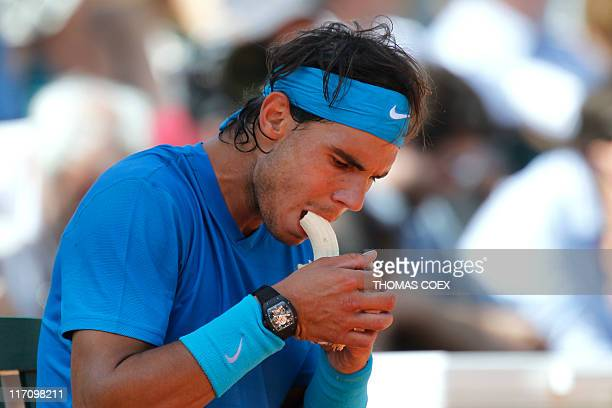 Spain's Rafael Nadal eats a banana as he plays against Britain's Andy Murray during their men's semi final match in the French Open tennis...