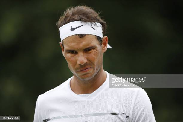 Spain's Rafael Nadal gestures during the men's singles exhibition match against Czech Tomas Berdych at The Hurlingham Tennis Classic tournament at...