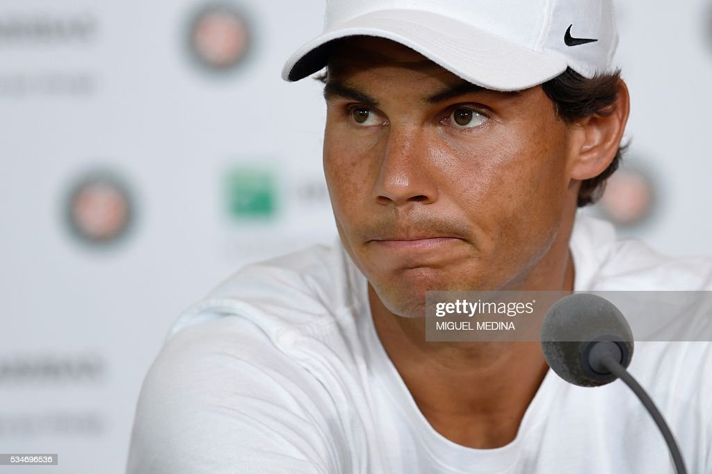 Spain's Rafael Nadal gives a press conference to annonce his withdrawal from the French Open at the Roland Garros 2016 French Tennis Open in Paris on May 27, 2016. Nine-time champion Rafael Nadal withdrew from the French Open with a left wrist injury today. 'It's not broken, but if I continue to play it will be broken in a few days,' said an emotional Nadal, the fourth seed. / AFP / MIGUEL