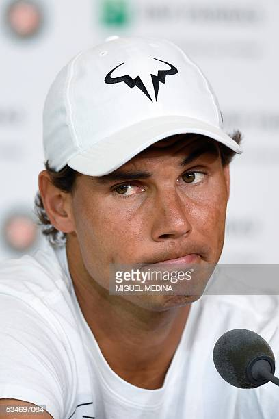Spain's Rafael Nadal gives a press conference to annonce his withdrawal from the French Open at the Roland Garros 2016 French Tennis Open in Paris on...