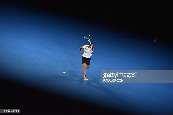 TOPSHOT Spain's Rafael Nadal hits a return against France's Gael Monfils during their men's singles fourth round match on day eight of the Australian...