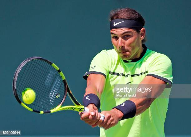 Spain's Rafael Nadal hits to France's Nicolas Mahut in the fourth round of the Miami Open at Crandon Park Tennis Center in Key Biscayne Fla on...