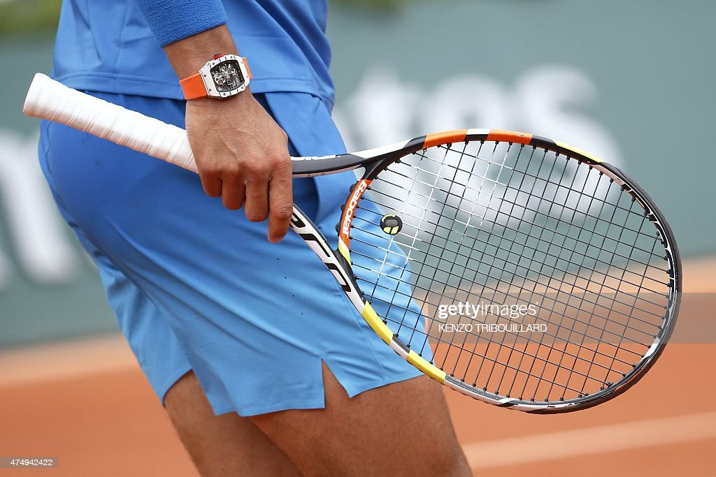 Spain's Rafael Nadal holds his racket during his match against Spain's Nicolas Almagro as part of the men's second round of the Roland Garros 2015 French Tennis Open in Paris on May 28, 2015.