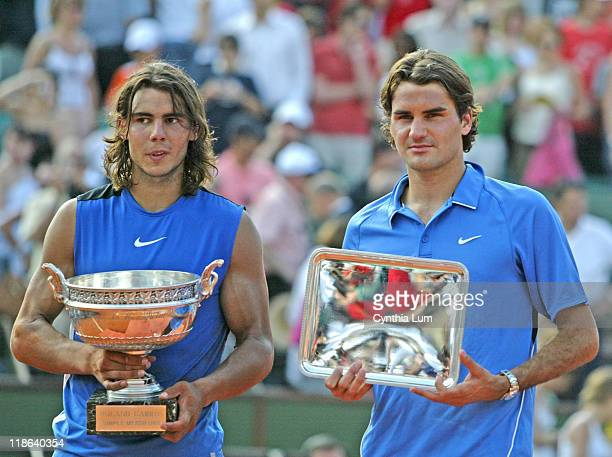 Spain's Rafael Nadal holds the championship trophy after defeating Roger Federer in the men's final of the 2006 French Open at Roland Garros Paris...