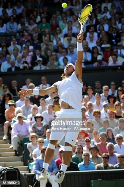 Spain's Rafael Nadal in action against Germany's Rainer Schuettler during the Wimbledon Championships 2008 at the All England Tennis Club in Wimbledon