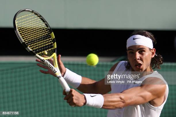 Spain's Rafael Nadal in action against Great Britain's Andy Murray during the Wimbledon Championships 2008 at the All England Tennis Club in Wimbledon