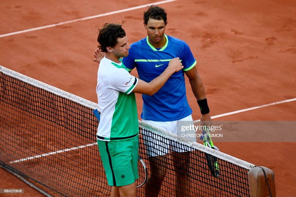 Spain's Rafael Nadal (R) is congartulated by Austria's Dominic Thiem after winning their semifinal tennis match at the Roland Garros 2017 French Open on June 9, 2017 in Paris. /