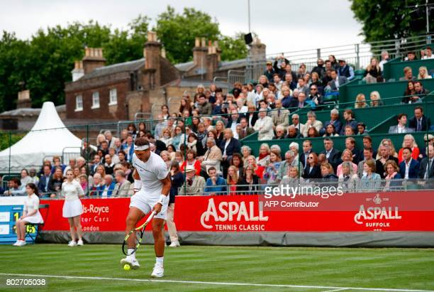 Spain's Rafael Nadal kicks the ball in his men's singles match against Czech Republic's Tomas Berdych at The Hurlingham Tennis Classic tournament at...
