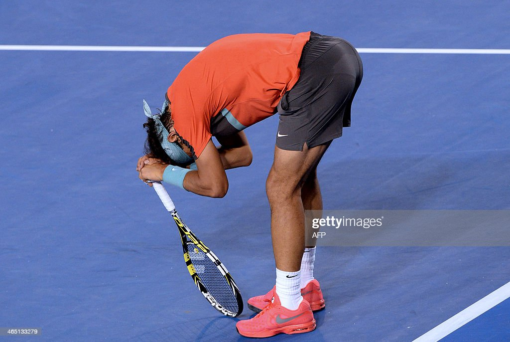 Spain's Rafael Nadal leans on his racquet during his mens singles final match against Switzerland's Stanislas Wawrinka on day fourteen of the 2014 Australian Open tennis tournament in Melbourne on January 26, 2014. IMAGE