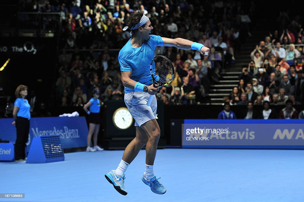 Spain's Rafael Nadal leaps in the air as he celebrates beating Switzerland's Stanislas Wawrinka during their group A singles match in the round robin stage on the third day of the ATP World Tour Finals tennis tournament in London on November 6, 2013. Nadal won 7-6, 7-6.