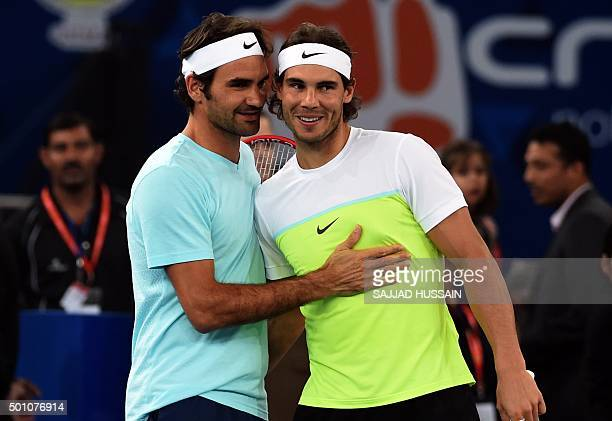 Spain's Rafael Nadal of the Indian Aces and Switzerland's Roger Federer of the Japan Warriors greet each other during practice at the International...