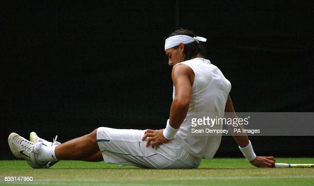Spain's Rafael Nadal on the floor after slipping during his match against Sweden's Robin Soderling at The All England Lawn Tennis Championship at...
