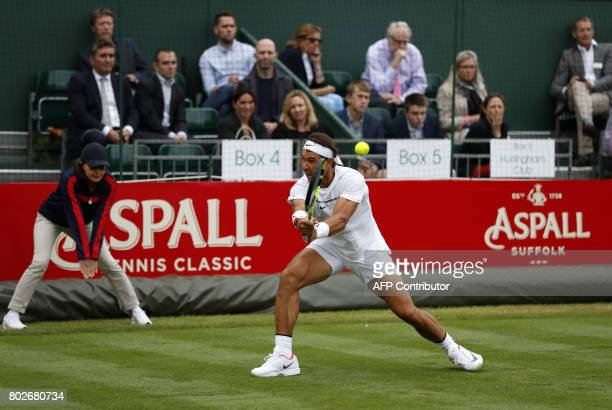 Spain's Rafael Nadal plays a shot against Czech Tomas Berdych during their men's singles exhibition match at The Hurlingham Tennis Classic tournament...