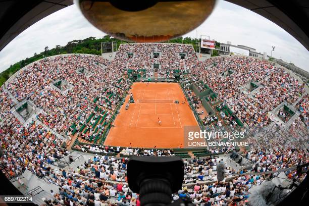 Spain's Rafael Nadal plays against France's Benoit Paire during their tennis match at the Roland Garros 2017 French Open on May 29 2017 in Paris /...