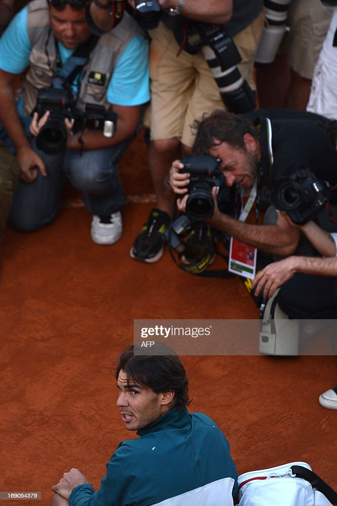 Spain's Rafael Nadal poses for photographers during the ceremony of the ATP Rome Masters on May 19, 2013. Nadal crushes Switzerland's Roger Federer 6-1, 6-3 to win seventh Rome title.