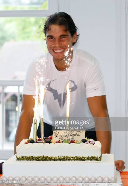 Spain's Rafael Nadal poses with a cake as he celebrates his 28th birthday during the French Open tennis tournament at the Roland Garros stadium on...