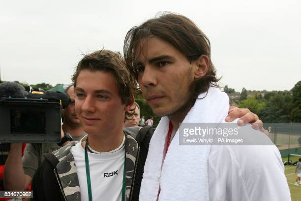 Spain's Rafael Nadal poses with a fan during the Wimbledon Championships 2008 at the All England Tennis Club in Wimbledon