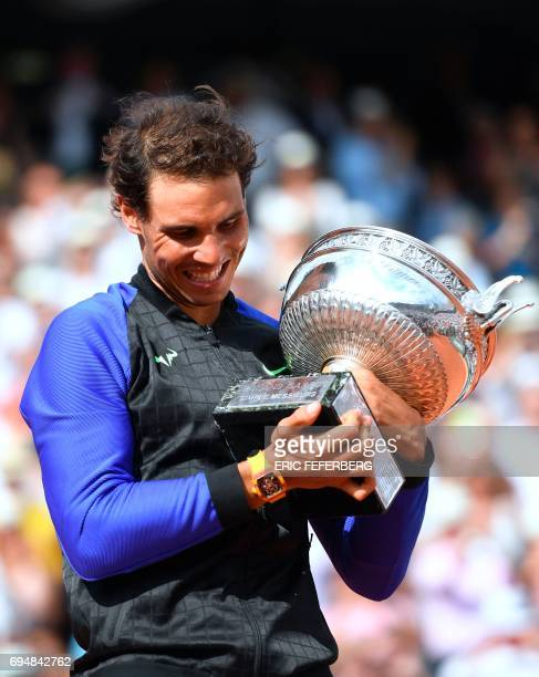 Spain's Rafael Nadal poses with his trophy after winning the men's final tennis match against Switzerland's Stanislas Wawrinka at the Roland Garros...
