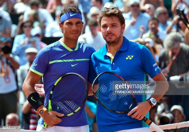 Spain's Rafael Nadal poses with Switzerland's Stanislas Wawrinka before the men's final tennis match at the Roland Garros 2017 French Open on June 11...