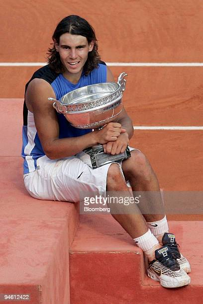 Spain's Rafael Nadal poses with the trophy cup after his win against Switzerland's Roger Federer at the men's final of the French Open tennis...