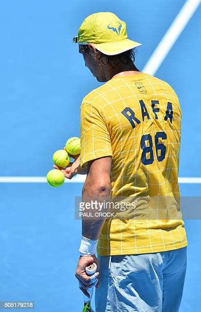 Spain's Rafael Nadal prepares to serve during a practice session ahead of the 2016 Australian Open tennis tournament in Melbourne on January 16 2016...