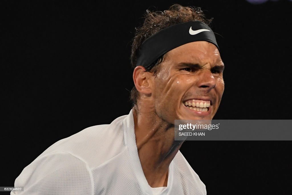 TOPSHOT - Spain's Rafael Nadal reacts after a point against Bulgaria's Grigor Dimitrov during their men's singles semi-final match on day 12 of the Australian Open tennis tournament in Melbourne on January 27, 2017. / AFP / SAEED