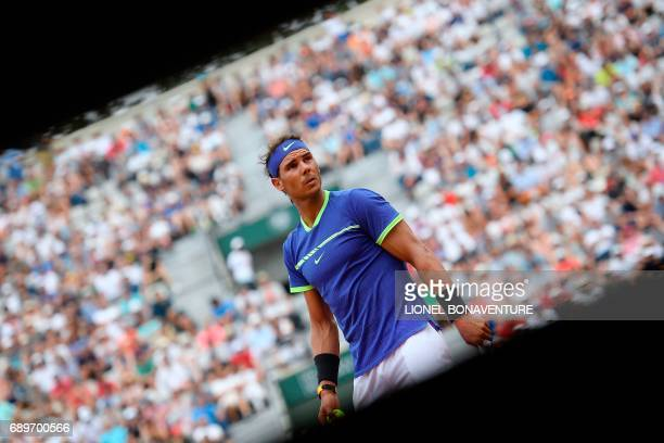 TOPSHOT Spain's Rafael Nadal reacts after a point against France's Benoit Paire during their tennis match at the Roland Garros 2017 French Open on...