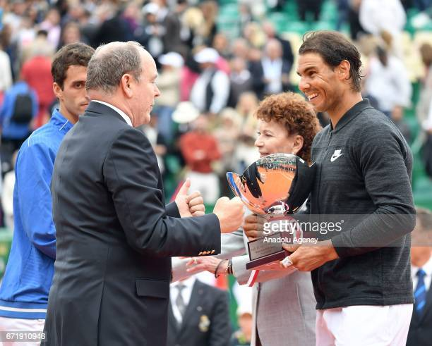 Spain's Rafael Nadal receives the trophy from Albert II Prince of Monaco after winning the MonteCarlo ATP Masters Series Tournament against his...